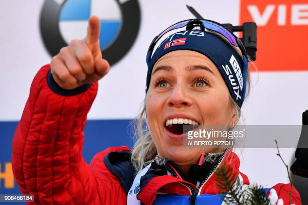 Winner Tiril Eckhoff of Norway celebrates on the podium after the Women's 75km sprint competition of the IBU World Cup Biathlon in Anterselva on...