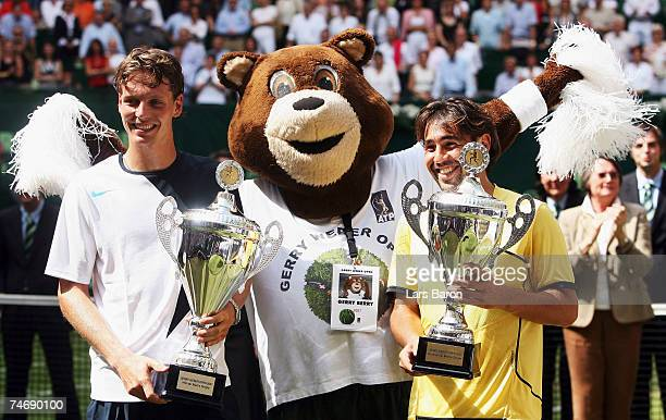 Winner Tomas Berdych of Czech Republic and 2nd placed Marcos Baghdatis of Cyprus pose with mascott of the tournament after the final match of the...