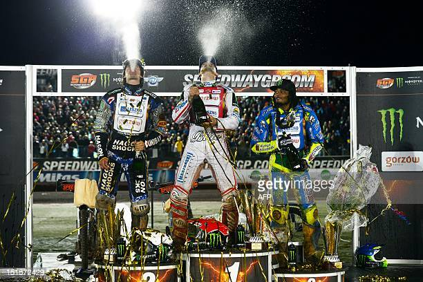 Winner Tomasz Gollob of Poland second placed Chris Holder of Australia and third placed Antonio Lindback of Sweden spray champagne on September 8...