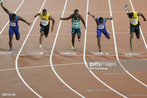 Winner US athlete Justin Gatlin Jamaica's Yohan Blake South Africa's Akani Simbine US athlete Christian Coleman Jamaica's Usain Bolt compete in the...