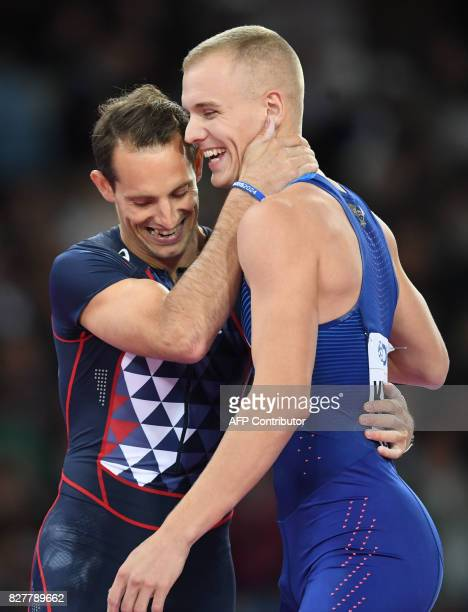 Winner US athlete Sam Kendricks and third placed, France's Renaud Lavillenie embrace after the final of the men's pole vault athletics event at the...