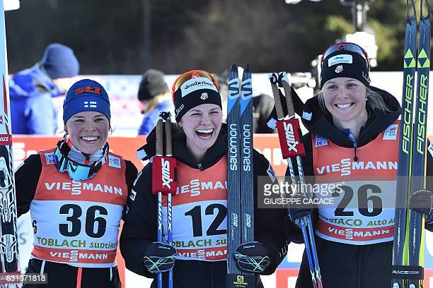 Winner US Jessica Diggins celebrates with Finland's secondplaced Krista Parmakoski and thirdplaced US Sadie Bjornsen during the podium ceremony of...