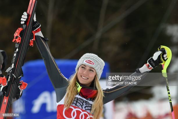 Winner US Mikaela Shiffrin celebrates after the FIS World Cup Women's Slalom event in Ofterschwang southern Germany on March 10 2018 / AFP PHOTO /...