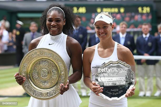 Winner US player Serena Williams poses with the winner's trophy the Venus Rosewater Dish next to runner up Germany's Angelique Kerber after the...