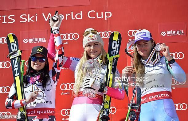 Winner US skier Lindsey Vonn secondplaced Austria's Anna Fenninger and thirdplaced Slovenia's Tina Maze pose on the podium of the FIS Alpine Ski...