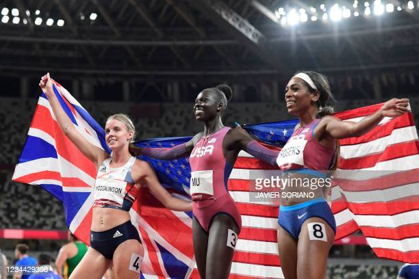 Winner USA's Athing Mu , second-placed Britain's Keely Hodgkinson and third-placed USA's Raevyn Rogers pose after competing in the women's 800m final...
