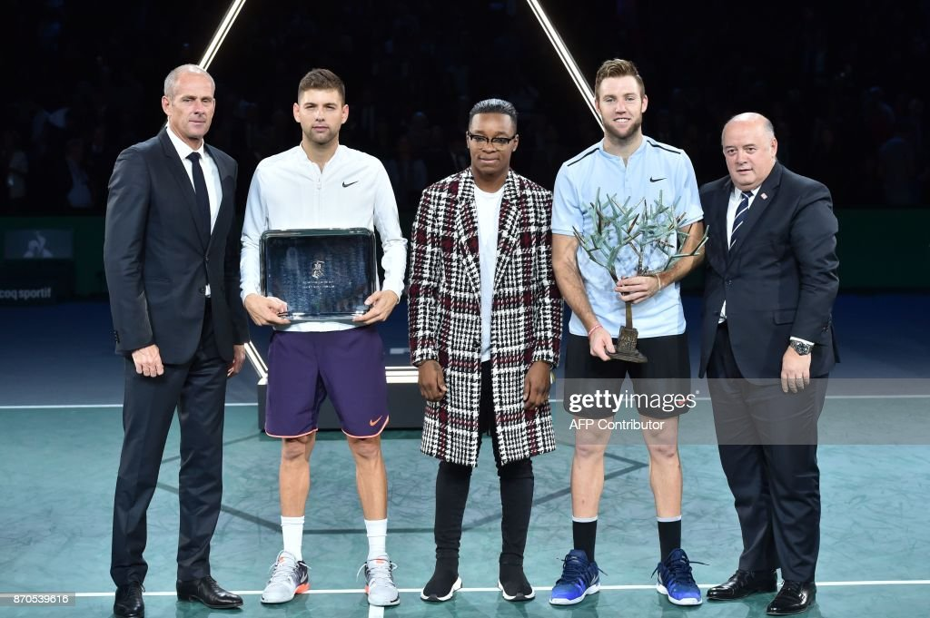 Winner USA's Jack Sock (2R) poses with the trophy next to second placed Serbia's Filip Krajinovic (2L), Paris Masters director Guy Forget (L), French judoka Audrey Tcheumeo (C) and President of the French tennis federation (FFT) Bernard Giudicelli (R) after the final of the ATP World Tour Masters 1000 indoor tennis tournament on November 5, 2017 in Paris. /