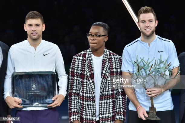 Winner USA's Jack Sock poses with the trophy next to second placed Serbia's Filip Krajinovic and French judoka Audrey Tcheumeo after the final of the...