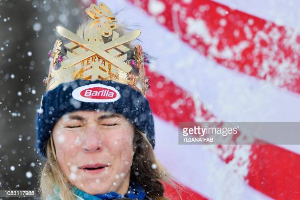 Winner USA's Mikaela Shiffrin reacts as her runnersup throw snowballs at her as they celebrate on the podium after the Women's Giant Slalom event of...