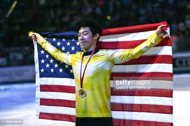 Winner USA's Nathan Chen poses with his medal and the US flag after the Men Free Skating program on December 7 2019 at the ISU Grand Prix of figure...
