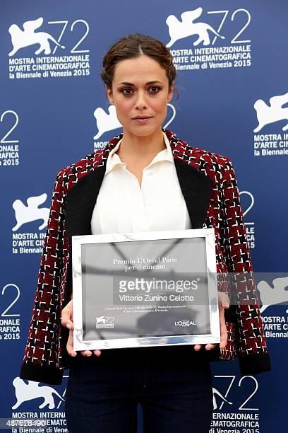 Winner Valeria Bilello poses with her 'L'Oreal Paris per il Cinema' award as she attends the photocall for the L'Oreal Paris Award For Cinema during...