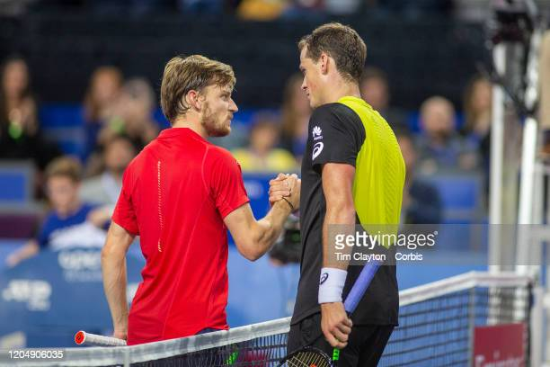 Winner Vasek Pospisil of Canada is congratulated at the net by David Goffin of Belgium after the Semi Final of the Open Sud de France Tennis...