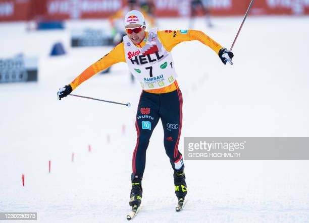Winner Vinzenz Geiger of Germany crosses the finish line of the FIS Nordic Combined World Cup in Ramsau am Dachstein, Austria, on December 20, 2020....