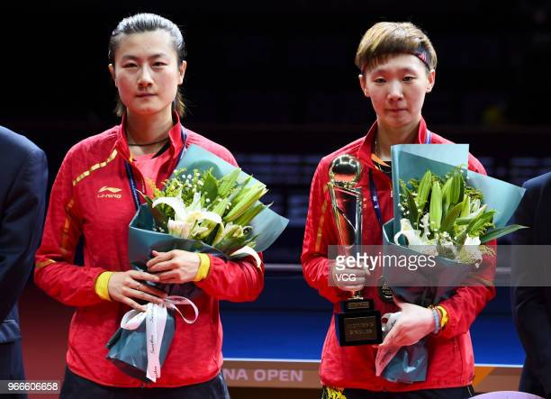 Winner Wang Manyu of China and runnerup Ding Ning of China attend awarding ceremony after women's singles final match on day four of the 2018 ITTF...