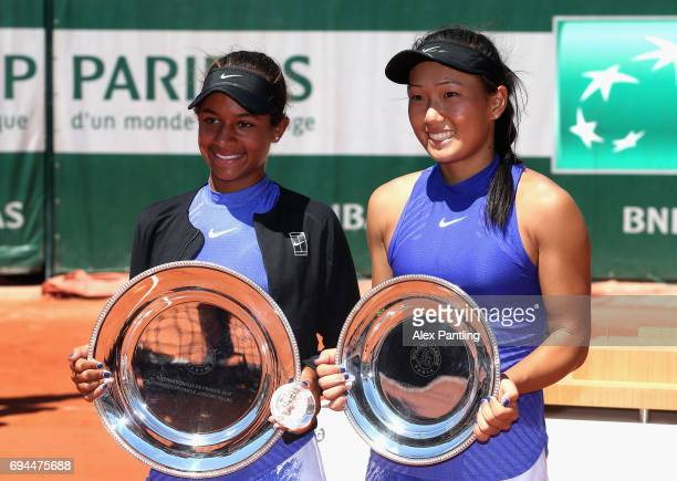 Winner Whitney Osuigwe of The United States and runner up Claire Liu of The United States pose for photos following the girls singles final on day...
