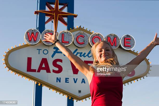 Winner with arms outstretched in front of Las Vegas sign