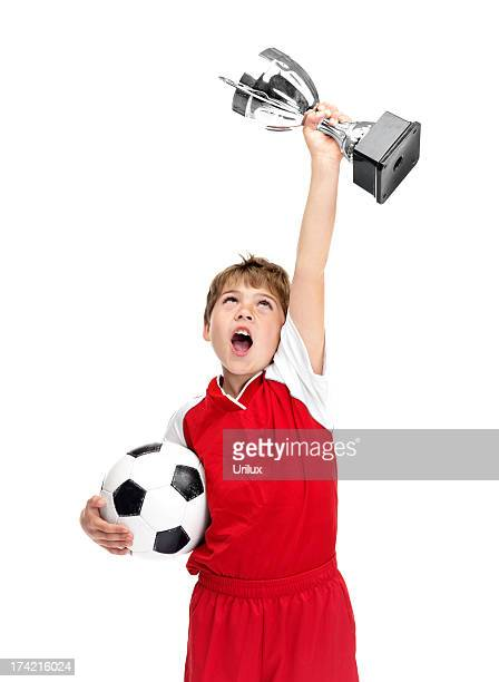 Winner - Young footballer proudly showing off his trophy