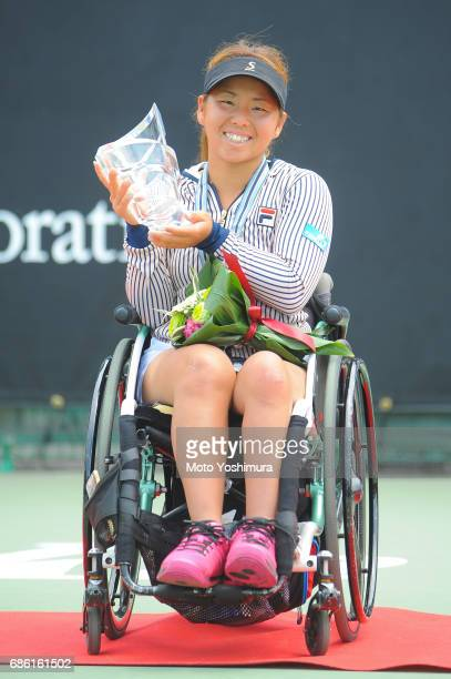 Winner Yui Kamiji of Japan celebrates with the trophy at the medal ceremony for the Women's Singles during day six of the Wheelchair Tennis Japan...
