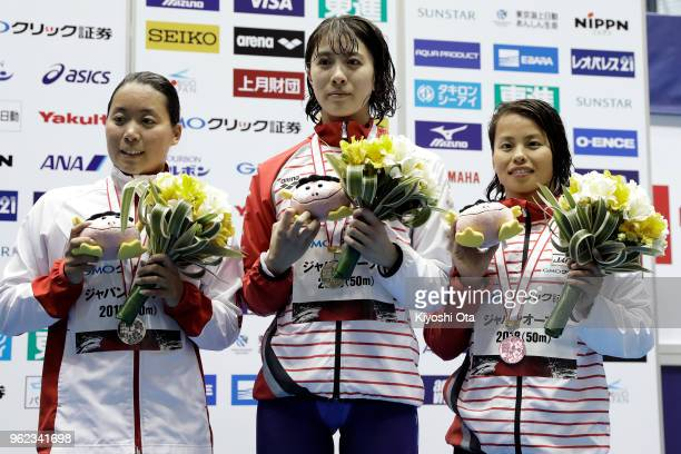 Winner Yui Ohashi of Japan celebrates with runnerup Miho Takahashi of Japan and thirdplaced Sakiko Shimizu of Japan after the Women's 400m Individual...
