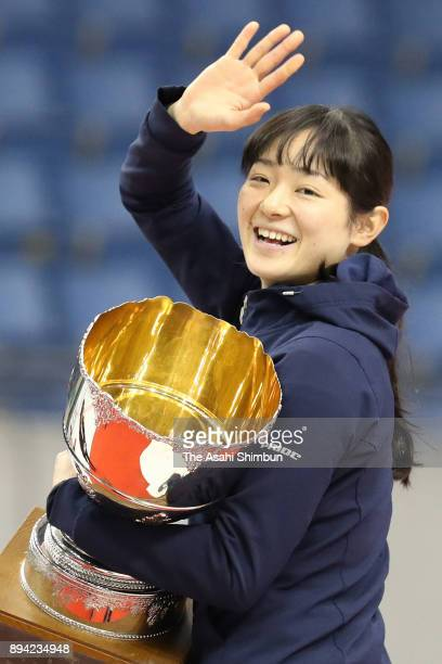 Winner Yuki Kikuchi celebrates on the podium after winning the Women's overall championship during day two of the 40th All Japan Short Track Speed...