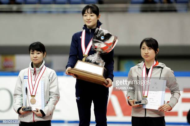 Winner Yuki Kikuchi celebrates with runnerup Aoi Watanabe and thirdplaced Hitomi Saito on the podium after winning the championship at the closing...