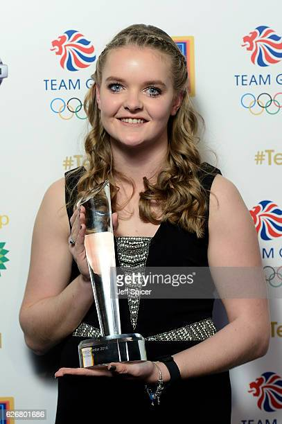 Winner Zoe Hainsworth poses with the Team GB's Ultimate Superfan award as she attends the Team GB Ball at Battersea Evolution on November 30 2016 in...