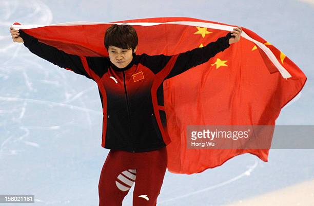 WinnerMeng Wang of China holds national flag to celebrate after the Women's 500m Final during the day two of the ISU World Cup Short Track at the...