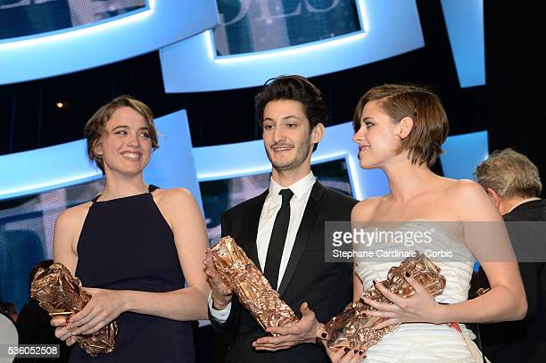 Winners Adele Haenel Pierre Niney and Kristen Stewart pose with their awards after 40th Cesar Film Awards 2015 Ceremony at Theatre du Chatelet on...
