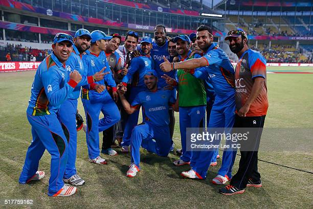 Winners Afghanistan get a picture with Chris Gayle of the West Indies during the ICC World Twenty20 India 2016 Group 1 match between Afghanistan and...