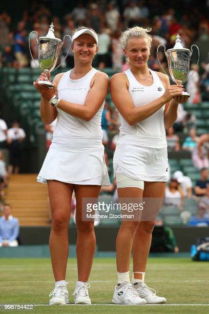 Winners Barbora Krejcikova and Katerina Siniakova of Czech Republic pose with their trophies after their victory against Nicole Melichar of The...