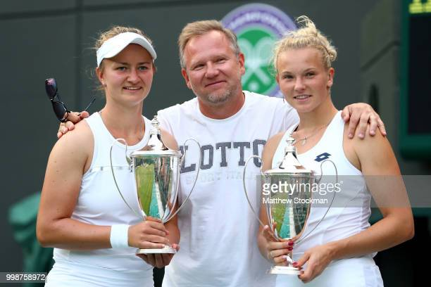 Winners Barbora Krejcikova and Katerina Siniakova of Czech Republic pose with their trophies and coach after their victory against Nicole Melichar of...