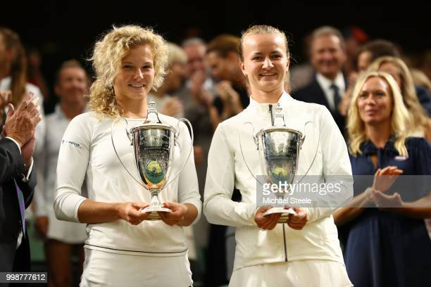 Winners Barbora Krejcikova and Katerina Siniakova of Czech Republic pose with their trophies inside Centre Court after their victory against Nicole...