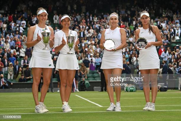 Winners Belgium's Elise Mertens and Taiwan's Su-Wei Hsieh pose with second place Russia's Elena Vesnina and Veronika Kudermetova at the end of their...