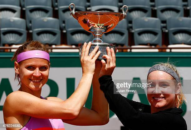 Winners Bethanie MattekSands of the United States of America and Lucie Safarova of Czech Republic celebrate pose with the trophy after the Women's...