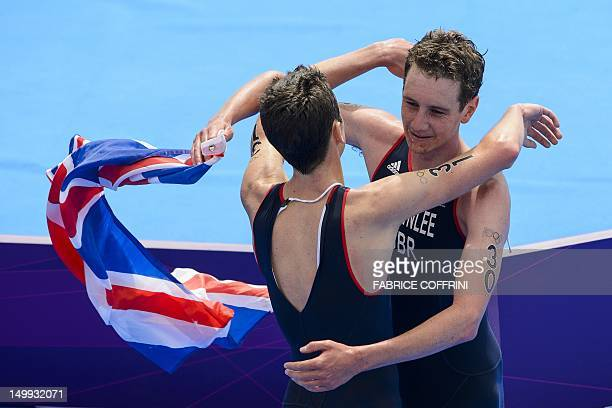 Winners Britain's Alistair Brownlee and his brother Jonathan Brownlee celebrate after respectively winning gold and bronze in the men's triathlon...