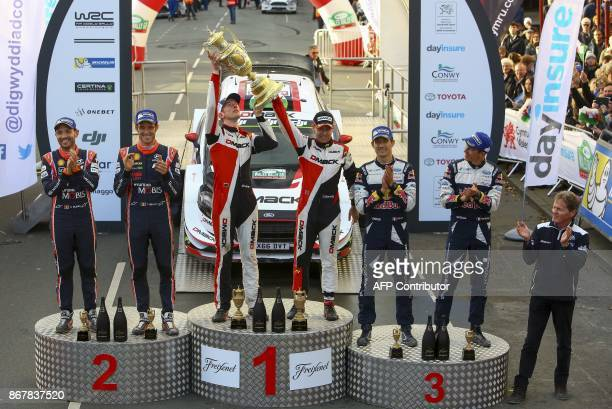 Winners British pilot Elfyn Evans and co pilot Daniel Barritt of the MSport World Rally runnersup Belgium's Thierry Neuville and co pilot Nicolas...