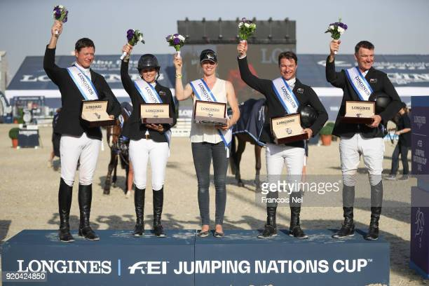 Winners Bruce Goodin Ulrika Goodin Samantha Mcintosh Daniel Meech and Richard Gardner receive price on stage at the President of the UAE Show Jumping...