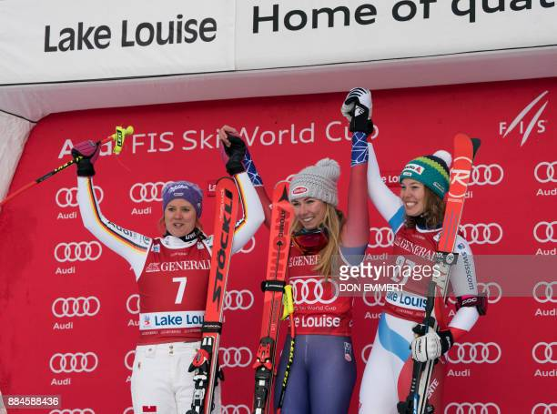 Winners celebrate their victories after of the FIS Ski World Cup Women's Downhill December 2 2017 in Lake Louise Alberta Viktoria Rebensburg of...