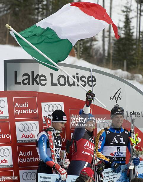Winners celebrate their victories in the FIS Ski World Cup men's downhill November 29 2008 in Lake Louise Alberta Canada Carlo Janko of Switzerland...