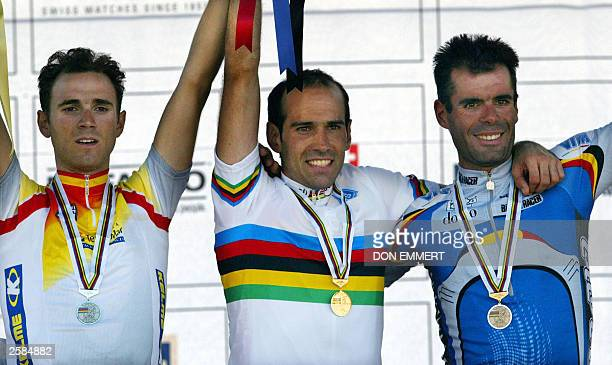 Winners celebrate their victories in the men''s individual road race 12 October 2003 during the World Cycling Championships in Hamilton Ontario...