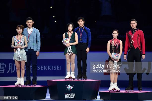 Winners China's Wenjing Sui and Cong Han second place China's Cheng Peng and Yang Jin and third place Russia's Anastasia Mishina and Aleksandr...