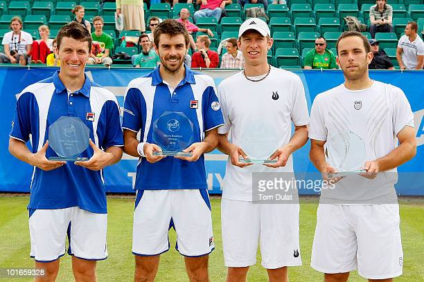 Winners Colin Fleming and Ken Skupski of Great Britain together with Eric Butorac and Scott Lipsky of the United States pose with the Aegon Trophies...