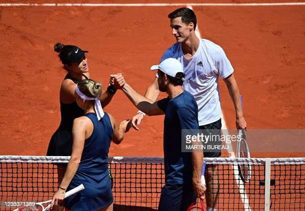 Winners Desirae Krawczyk of the US and Britain's Joe Salisbury shake hands with second-placed Russia's Elena Vesnina and Russia's Aslan Karatsev at...