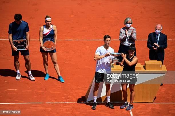 Winners Desirae Krawczyk of the US , Britain's Joe Salisbury and second-placed Russia's Elena Vesnina , Russia's Aslan Karatsev , pose with their...