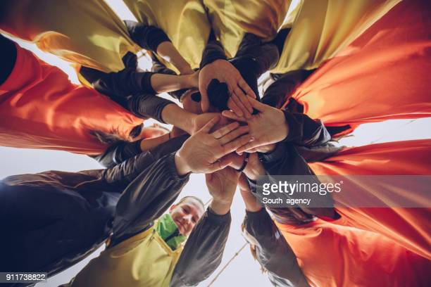 winners do whatever it takes - huddling stock pictures, royalty-free photos & images