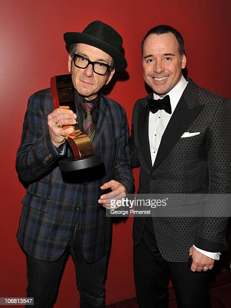 Winners Elvis Costello and David Furnish attend the 25th Annual Gemini Awards Gala at the Winter Garden Theatre on November 13, 2010 in Toronto,...