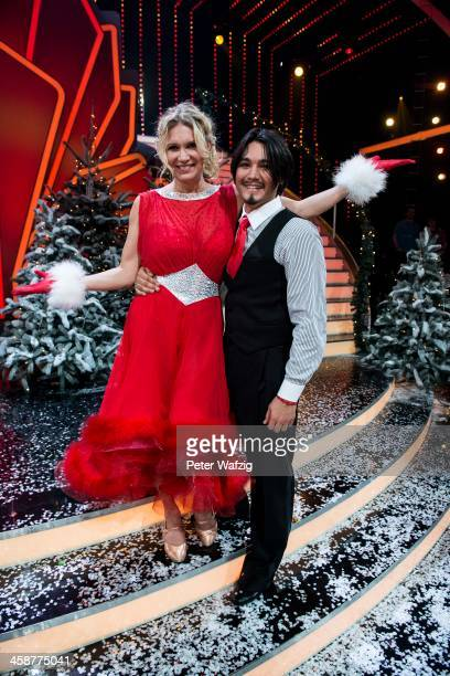 Winners Erich Klann and Magdalena Brzeska pose after the Final of 'Let's Dance - Let's Christmas' TV Show on December 21, 2013 in Cologne, Germany.