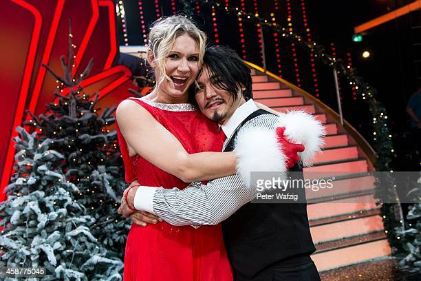Winners Erich Klann and Magdalena Brzeska pose after the Final of 'Let's Dance Let's Christmas' TV Show on December 21 2013 in Cologne Germany