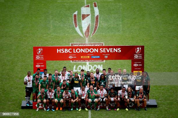 Winners Fiji runnersup South Africa and third place finishers Ireland pose for a photo on day two of the HSBC London Sevens at Twickenham Stadium on...