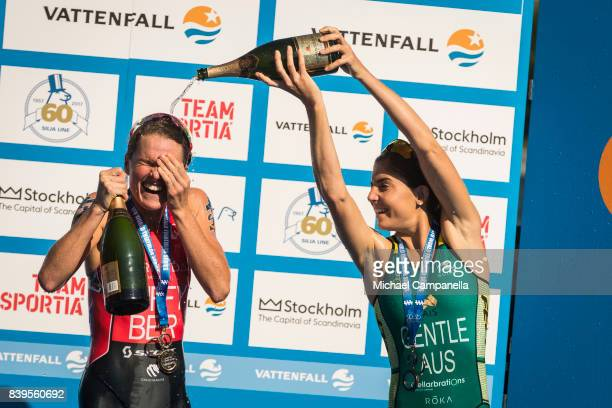 Winners Flora Duffy of Bermuda and Ashleigh Gentle of Australia spray champagne on the winner's podium after the women's elite race of the Vattenfall...
